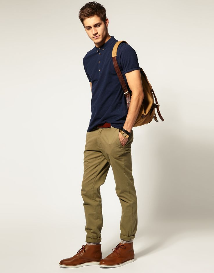 Tan/Sand color chinos, desert boots, navy short-sleeved dress shirt.