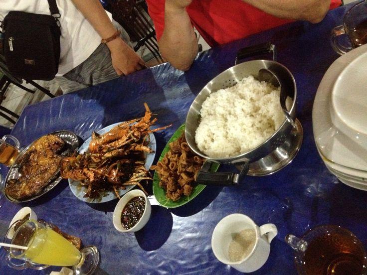 big seafood party dude!! in pangandaran beach, West Java, Indonesia.