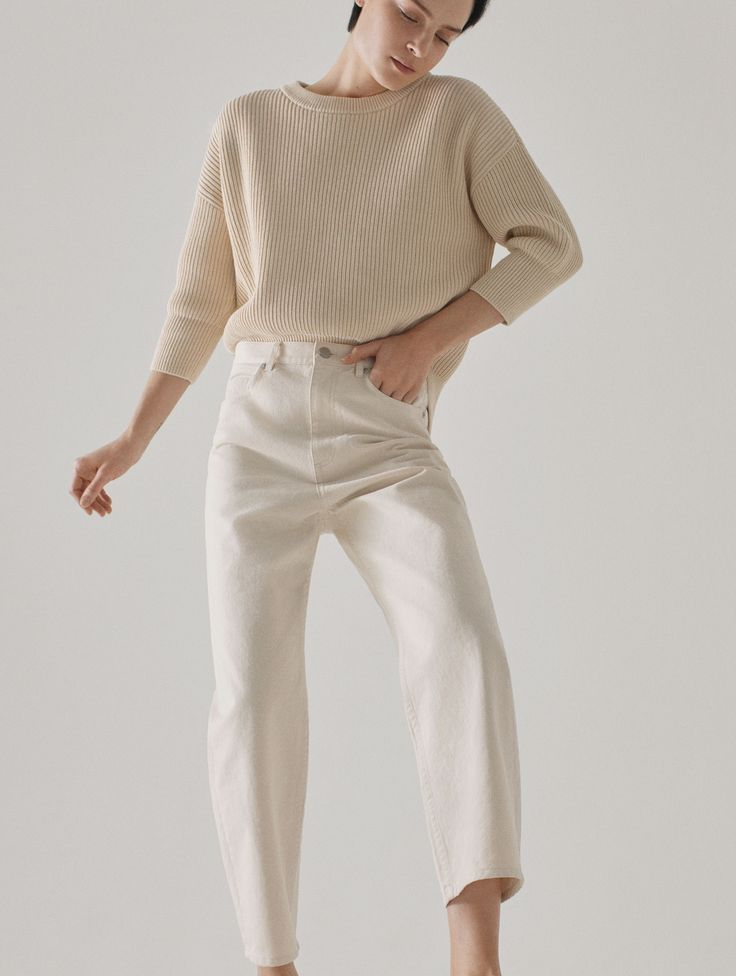 COS | cream tailored trousers and cream sweater.