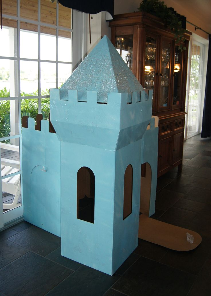 Frozen birthday party decorations--Elsa's snow castle.  I took a prefab cardboard castle, spray painted it Elsa blue, and added glitter.