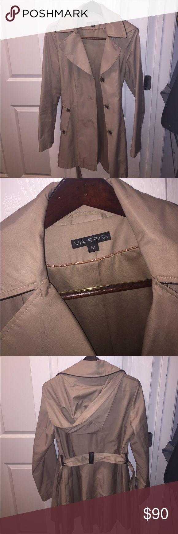 Via Spiga Rain Coat in Tan Worn less than 5 times. Tan Raincoat with hood and wrap belt. Buttons down middle. Pockets on both sides. $90 OBO. Via Spiga Jackets & Coats Trench Coats