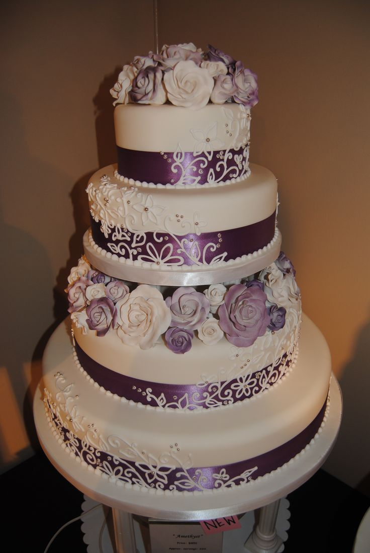 "Fondant wedding cake with purple and lace detail and roses. ""Amethyst"" www.artisticcakedesign.ca #weddingcake #wedding #cake #roses #lace #ribbon"