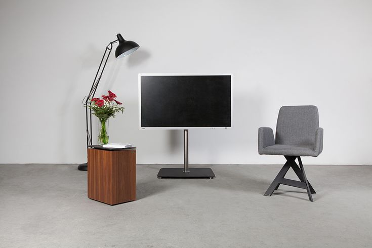 """TV Stand / Ständer  Less is more: functional TV stand with ability to rotate TV 360°.  Image center approx. 100 cm (39.4 inches)  Cables are hidden in the column.  For 40"""" to 75"""" TVs (up to 55 kg; 121 lbs.) with Vesa wall mounts 100 to 400 (also available up to 600)."""