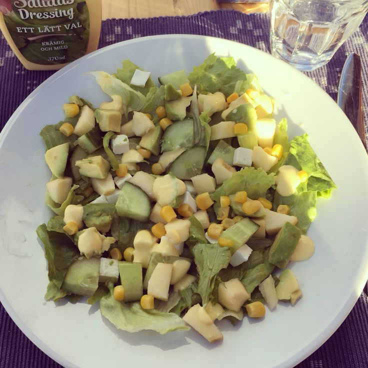Fresh green salad with avocado, apple, corn & feta cheese