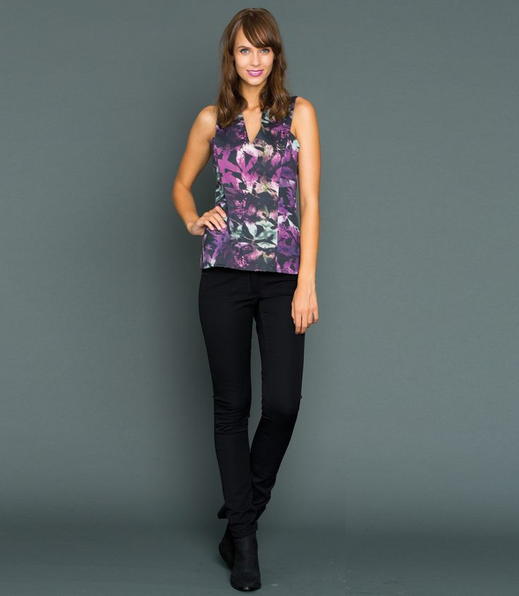 Made from 96% Cotton and 4% Elastane fabric, this fitted top features a flattering V neckline, as well as thick shoulder straps that cross over at the back . Finished with panel seaming and a slight peplum hem. Fastened with a invisible zip back. Style with our Black Skinnies and heeled ankle boots.  Model is 5'11 and wears a size 8