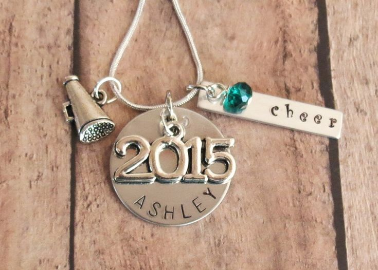Perfect for your senior who is graduating from high school this year or next, personalized hand stamped necklace with 2015/2016 Graduation charm, Megaphone Cheer charm and your choice of bead color. Comes with your choice of 18 or 20 inch silver-toned snake chain. The round disc measures 1 and is matte/slightly distressed aluminum. The rectangular disc is 1.25 and says cheer. This version comes with the Megaphone charm however if you would like a necklace with a different style of charm, and…