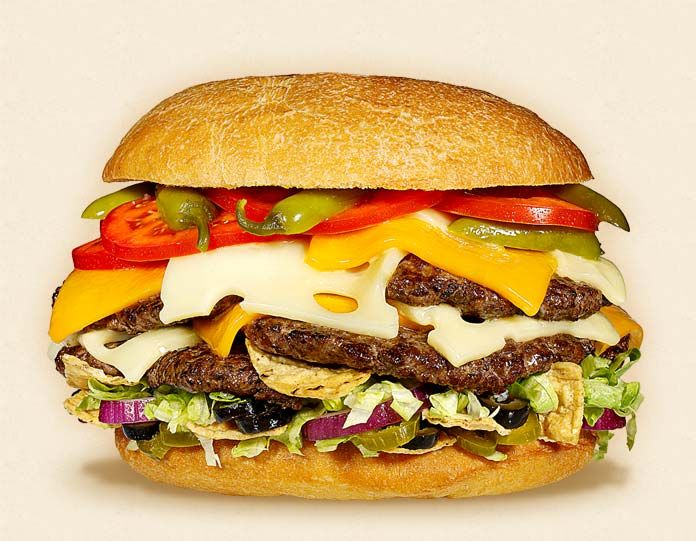 The Macho Nacho:  Wisconsin Cheddar and Swiss Cheeseburger Recipe.  Other ingredients:  4 to 8 beef patties, pickled jalapenos, iceberg lettuce, tomatoes, tortilla chips, sliced red onions, black olives, and big burger bun.   - Wisconsin Milk Marketing Board