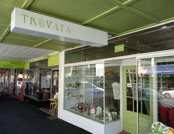 Trovata underawning signage, white non illuminated ceiling suspended box with logo decal overlay