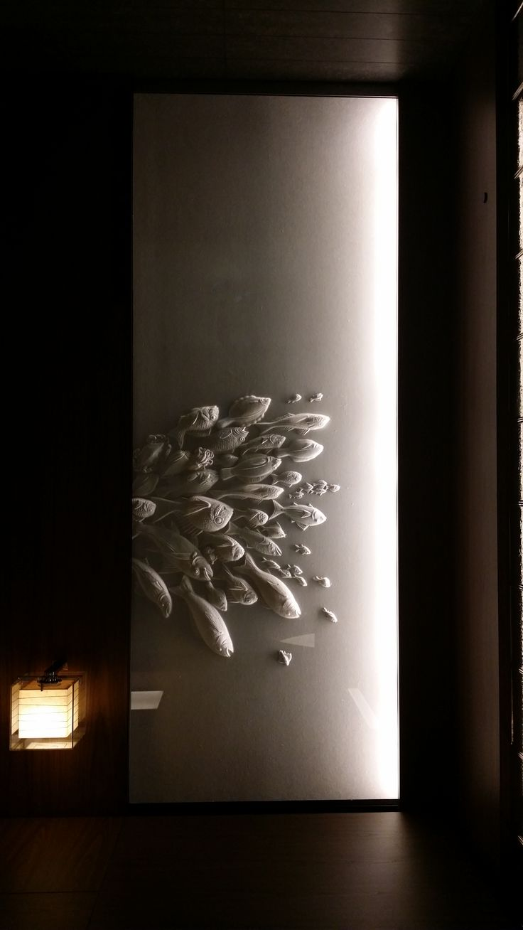 andaz东京 Great use of light on texture. Leaping fish