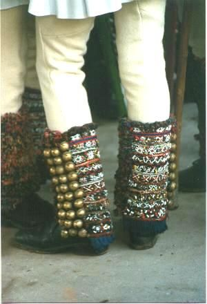 Romanian mens costume Gura Râului - Sibiu Decorated leg wraps (ghetre) worn over shoes or boots (bocanci) by căluşer dancers in southern Transylvania. They are made of woollen or knitted wool and decorated with coloured embroidery and rows of bells. Photo taken in village of Gura Râului, Mărginimea Sibiului in April 1988