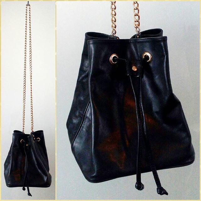 90s black leather bucket bag with sturdy gold tone chain shoulder strap.