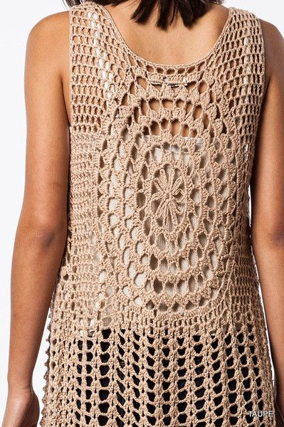 """Style: You'll be feelin groovy in this taupehippie inspiredopen crochet long fringe vest.It's your bohemian free spirit yearning to be free. Material: 60% Cotton/40% Polyester Enclosure: Open Length: 44"""""""