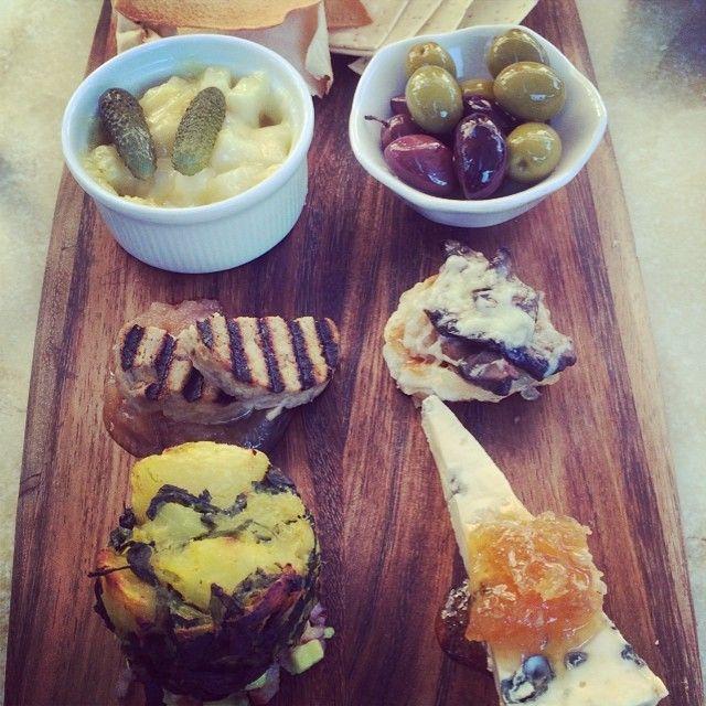 Melted raclette, Marinated olives, Duck, Mushroom & gruyere tart, Potato & spinach & Blue truffled honeycomb | Wine Odyssey