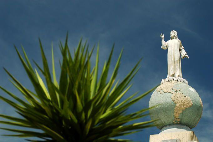 """Lonely Planet El Salvador:  Statue """"El Salvador del Mundo"""" (Saviour of the World), symbol of El Salvador, depicting Jesus standing on top of the world."""