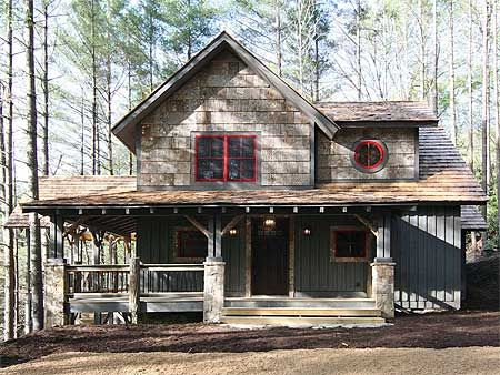 I love the rustic cabin feel! Perfect simple floor plan for a big family.
