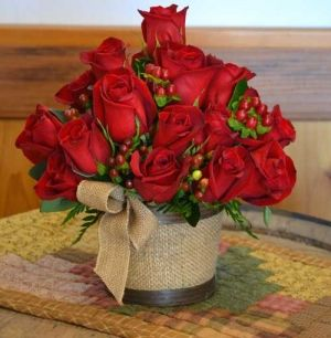 red roses, red hypericum berries, burlap in tin. Maybe use Gerber daisies instead on the roses.