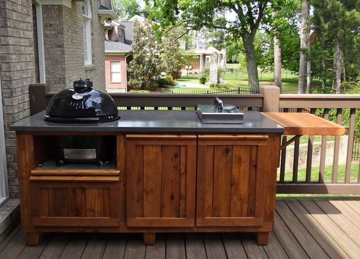 new toy for the boys.  deckkitchen.com custom pieces for the primo and big green egg grills.