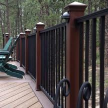 Trex Reveal Aluminum Railing Balusters in Charcoal Black. Features Composite Posts with Reveal Baluster infill in Charcoal Black