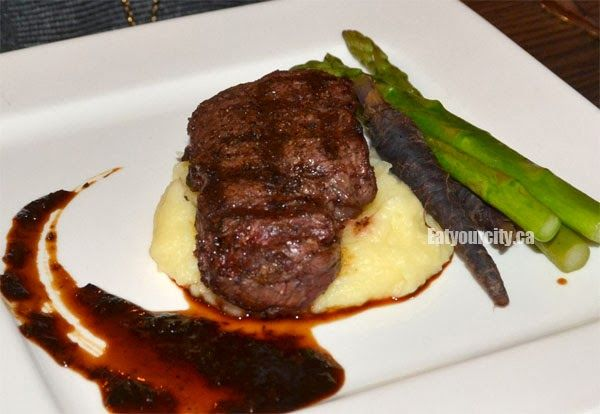 The River House 8 oz Tenderloin served with Asparagus, Seasonal Carrots, Black Pepper Sauce, and Mashed Potato Parsnip Vanilla Puree and Squash Chips