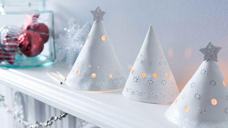 Illuminated lanterns on a shelf | Christmas tree cone lanterns | Tesco Living