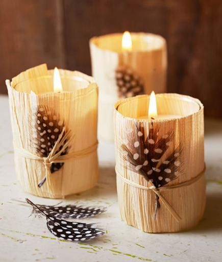 Corn Husk Votive Holders - Bring a touch of autumn whimsy to your tabletop with adorable corn husk votive holders. Simply wrap small glass votive holders with trimmed corn husks and secure them in place with thin ribbon or string. Sometimes dried corn husks can be difficult to work with, but moistening them with water can make them more pliable. Tuck a guinea fowl feather from your local craft store into the ribbon for a charming finishing touch.
