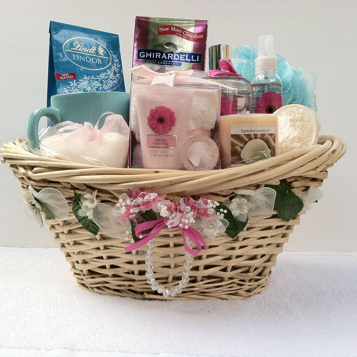 (Spa Gift Basket) Vera Mae Collection /Infusion  Colors of Pink and Blue infuse together such beautiful soft colors for that special someone give a gift of love with:  Soap Rose Petals, Cup, Bath Salt, Candle, Sponge cleansing body bar Foot lotion & Spa Socks, Body Spray, Hand Soap,  Shower Gel, Lindt Lindor Irresistibly smooth sea salt milk chocolate truffles Ghirardelli chocolate squares dark& raspberry rich chocolate luscious filling.