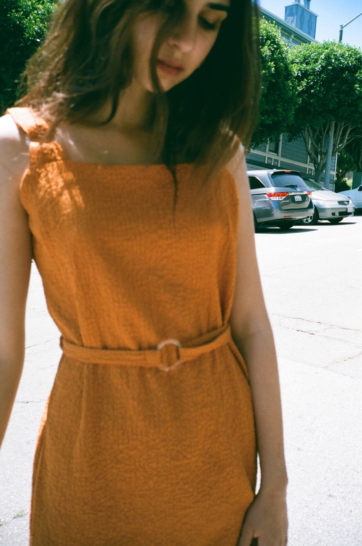 The dress that proves clothes can be both comfortable and flattering. This orange shift dress has a loose ...