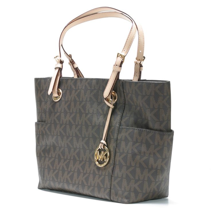 Michael Kors Brown Signature Tote Bag Bring designer style to your casual look.