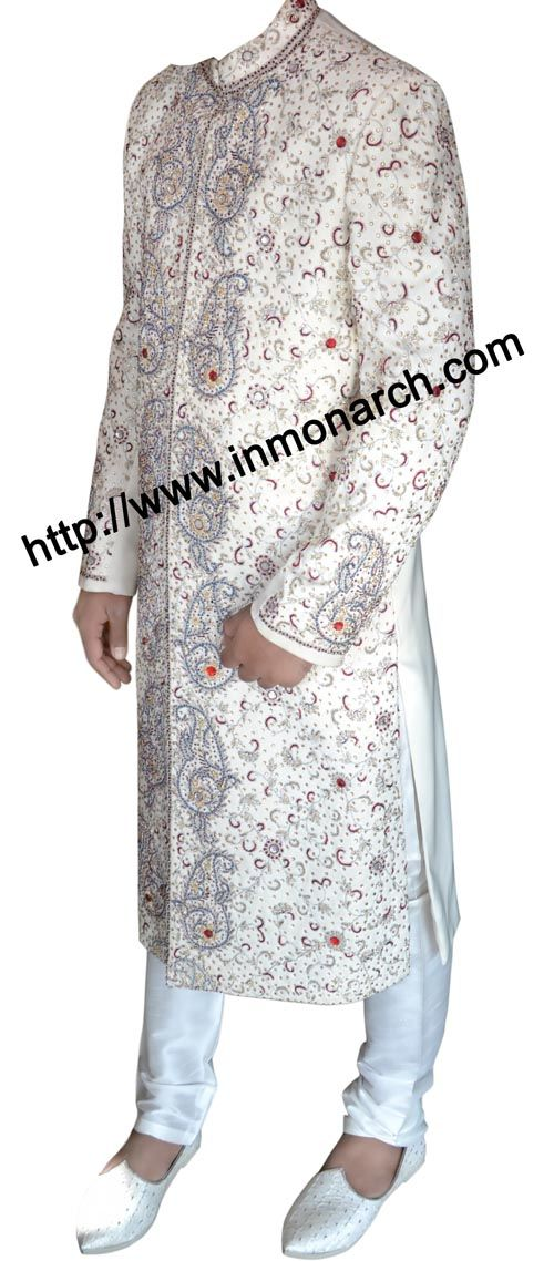 Beautiful designer work cream color polyester fabric wedding groom sherwani. Embroidered elegantly on neck, collar, front till bottom and sleeve cuffs. It has white churidar pyjama at bottom.