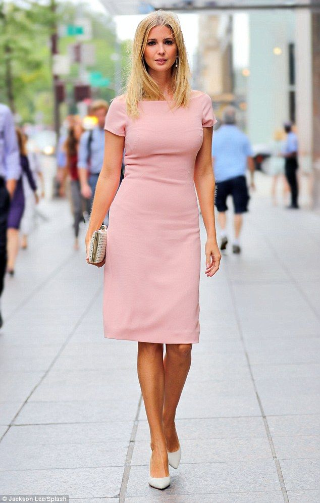Walking the walk: Ivanka sported a figure-hugging pink dress on her first official day back to work after the holiday weekend on Tuesday