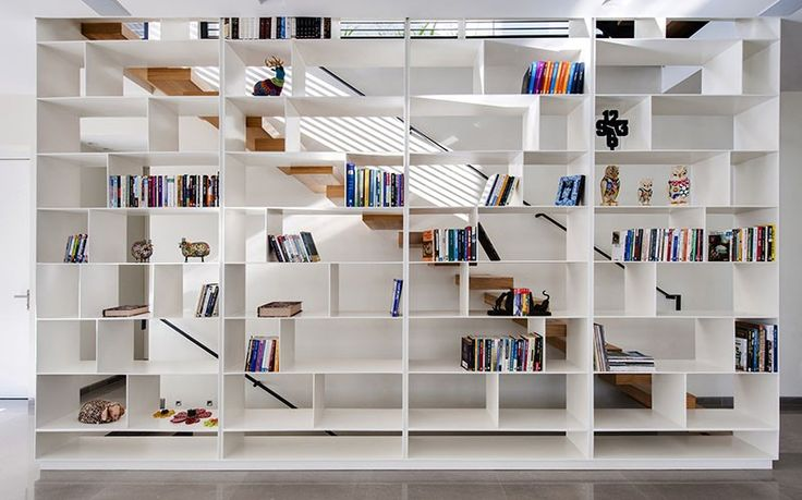 Wall of shelves  Very interesting way of using open shelving for staircase railings--both up and down