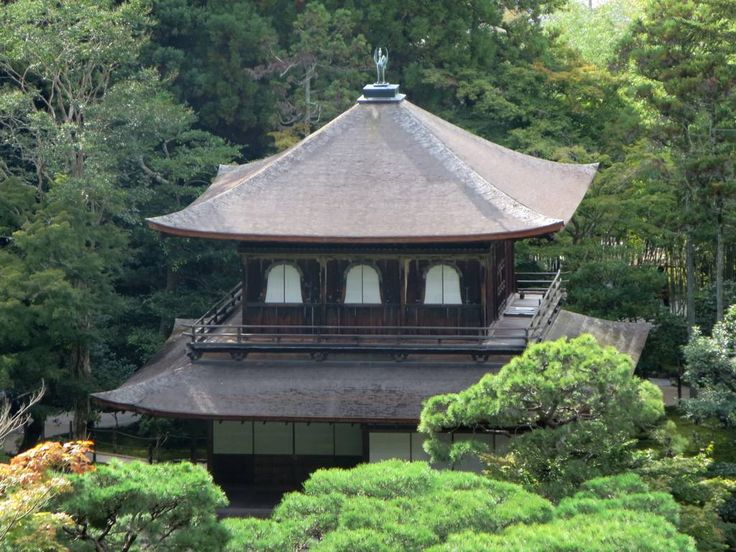 A bronze phoenix crowns the roof of the Silver Pavilion at Ginkakuji Temple in Kyoto, Japan. The builder died in 1489 before the building could be covered with silver as planned.