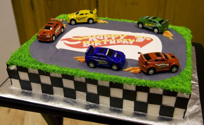 Race Car Birthday Cake...like the sheet cake and sides...dont like the top so much though.  Good idea....