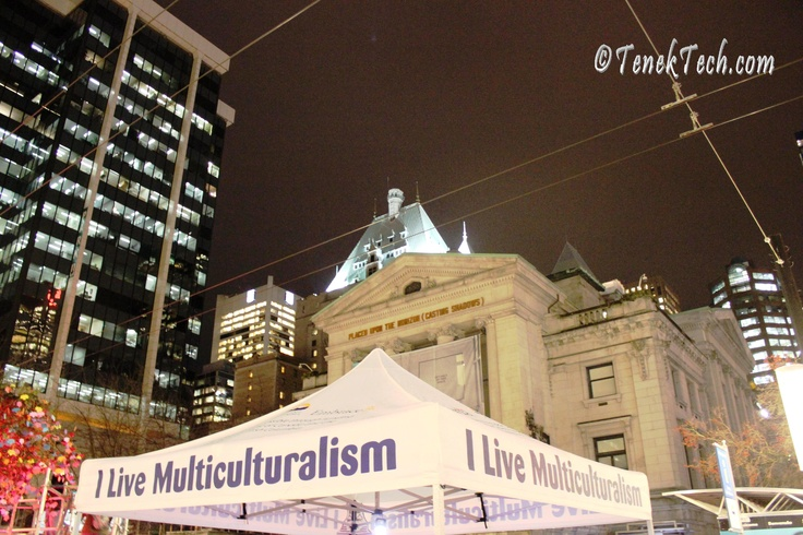 """""""I live multiculturalism"""" Multiculturalism Week art installation in Vancouver's Robson Square - Nov 2012. It features a maple tree that members of the public are dressing with paper leaves and messages of how they 'live multiculturalism'."""