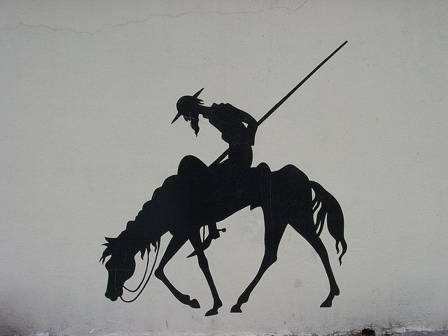 a painting of don quixote and rocinante on the wall of the university library in bogota, colombia