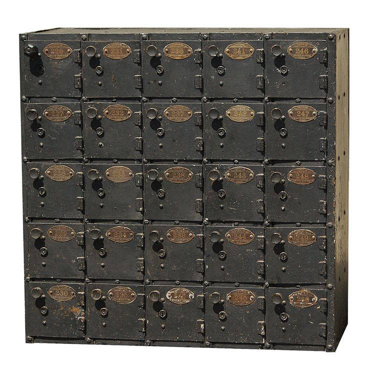 Very functional set of c. 1920's safe deposit boxes. Sheet metal and iron construction with original brass number tags . Manufactured by Ter...