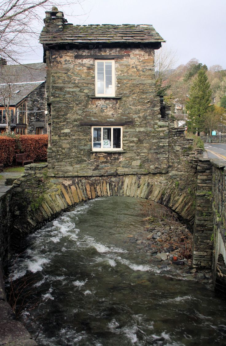 Bridge House, Ambleside, England. was built in the 18th century as an apple store for Ambleside Hall. It was constructed over Stock Beck in order to avoid land taxes