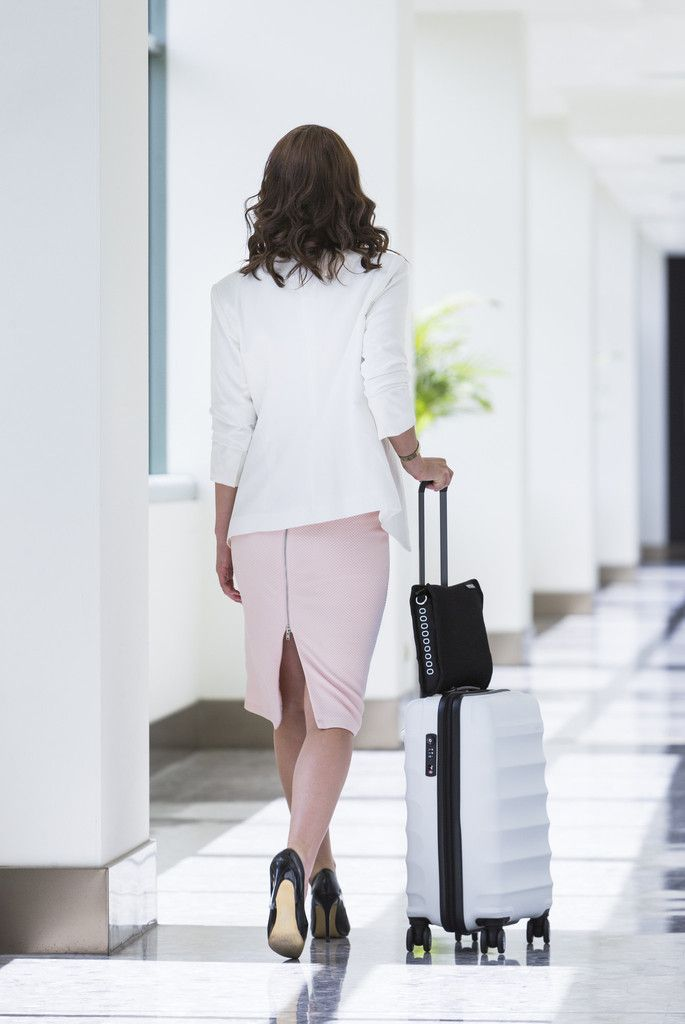 Airpocket - a simple, stylish and protective carry-on to organise all your travel essentials into one convenient and accessible bag. There's a handy trolley sleeve to slip it over the rolling luggage handle.