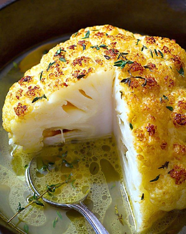 Whole Roasted Cauliflower With Butter Sauce Ingredients 1 head of cauliflower Fresh thyme 2 bay leaves 4 cups (1l) vegetable or chicken stock, more or less, depending on the size of the cauliflower 1/3 cup (70)g