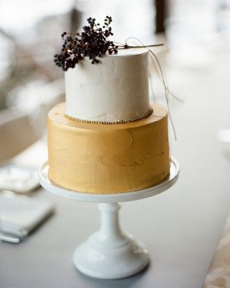 This petite wedding confection was an orange blossom honey sponge cake with vanilla bean Swiss meringue buttercream, layered with kumquat-Champagne confit.