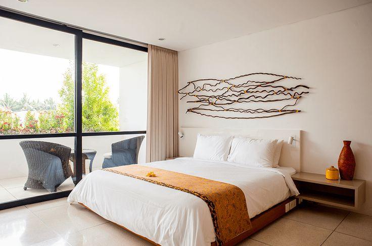 The second floor double bedroom and balcony at Muse Villa, Seminyak, Bali