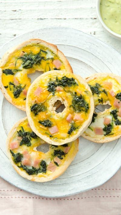 Bagels are the perfect vessel for this ham, egg and spinach breakfast with creamy basil avocado dip.