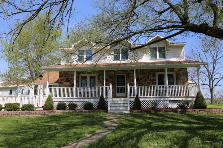 Farm house for sale in the heart of the Ozarks of Mtn. Grove, Mo. This two story Native Rock Amish home from 1940 has all of its electricity and plumbing throughout, central heat and air with 5 bedrooms and 2 full bathrooms with newer flooring installed recently. In ground pool with privacy fence on back of home. Located on 15 acres with a pond, old hay barn and rock shed from 1940. Additions to the farm include a large shop used for cabinet making that has over 2900 sq ft.