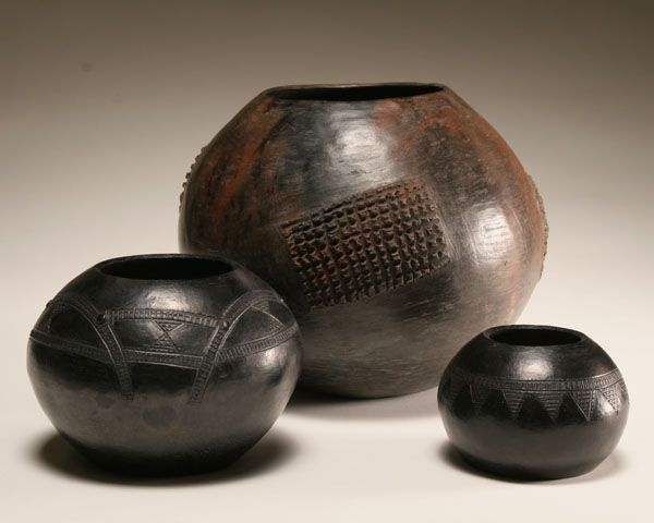 Africa | Three clay beer pots, 'Nguni', from South Africa.