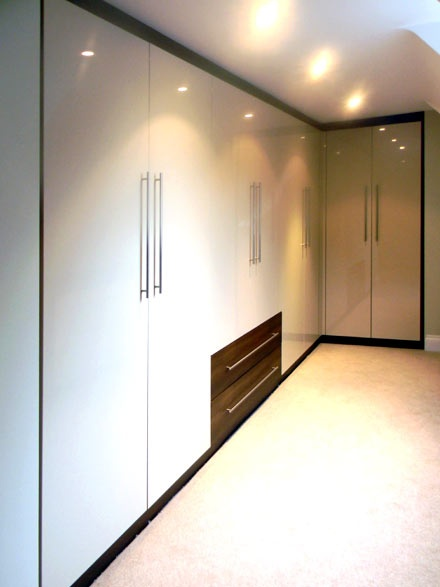 Glossy wardrobes Wood Rose Interiors offers super space savers.