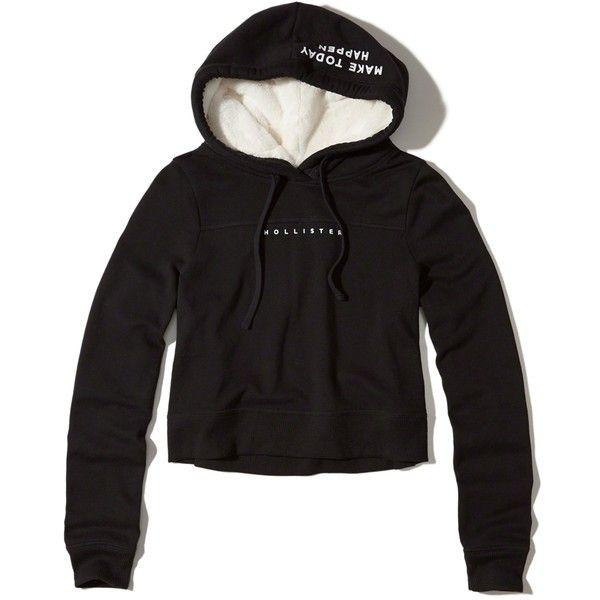 Hollister Logo Crop Sherpa-Lined Hoodie ($45) ❤ liked on Polyvore featuring tops, hoodies, black, hooded hoodie, hooded sweatshirt, cropped hoodies, graphic hoodie and logo hoodie