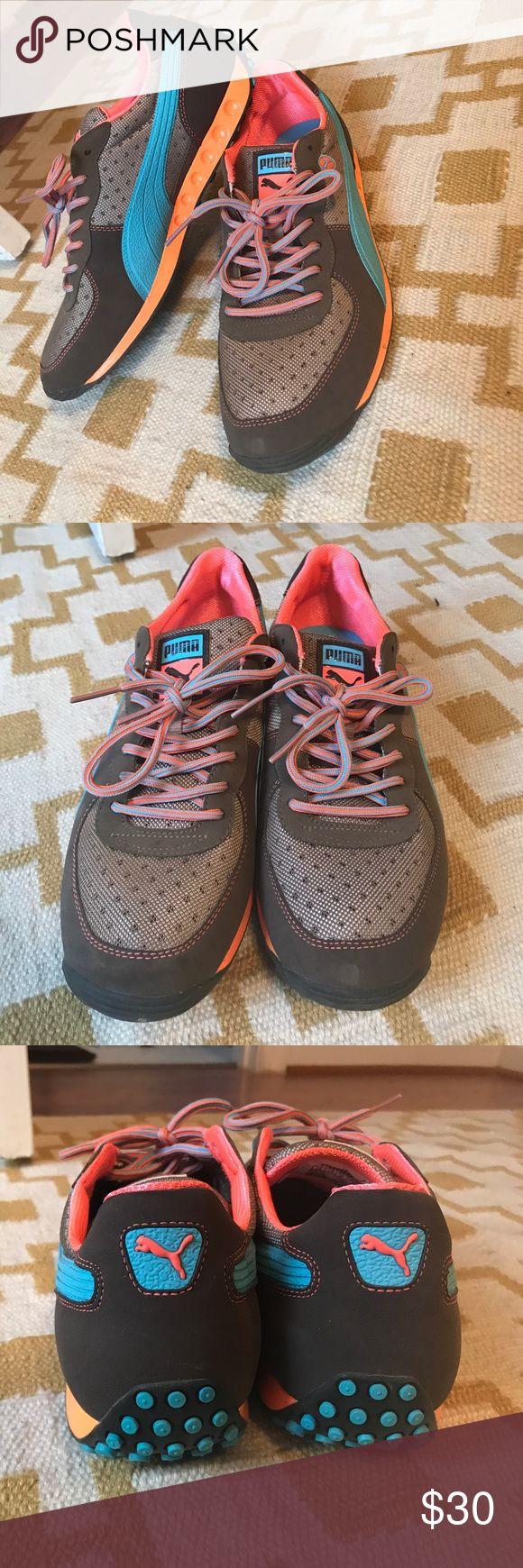 Brown, blue orange, men's Puma trainers SZ 10.5 Almost new men's Puma trainer only worn twice. Brown, orange and blue. Great as a street shoe or fashion statement. US size 10.5, EU 44 Puma Shoes Athletic Shoes