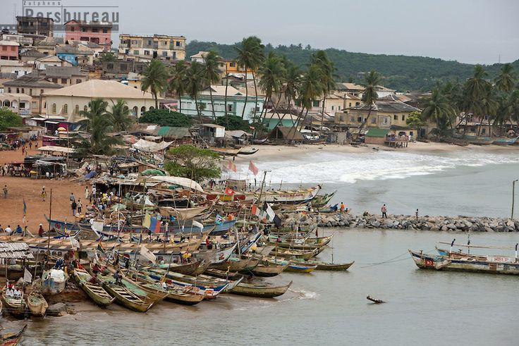 Fishing boats in the harbour next to Elmina Castle. Ghana.