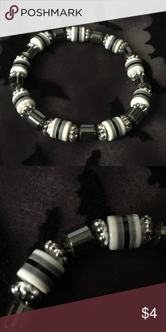 Grayscale Beaded Bracelet 1 Piece Color(s): Gray, Black, White, Silver Type: Bracelet  Brand: Unknown Length: N/A Material(s): Plastic, Metal Charms/Beads: Striped plastic beads, metal beads  Quality: New without tag Other Significant Details: Stretchy Disclaimer: All measurements are APPROXIMATE and to the nearest inch. All flaws of the item(s) is disclosed. I will not accept any lowball offers. Tags: pretty cute unisex edgy goth emo scene punk gothic men mens cool neutral dark simple plain