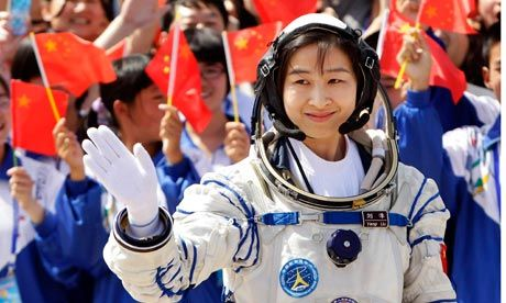 Liu Yang, China's first female astronaut, waves during a departure ceremony at Jiuquan Satellite Launch Centre in Gansu province. Photograph: Jason Lee/Reuters.  China's first female astronaut shows how 'women hold up half the sky'.  The famous Chinese maxim has it that women hold up half the sky. Thanks to Liu Yang, they have now soared past it.  On Saturday a Shenzhou-9 spacecraft blasted off from its Gobi desert launch site carrying the first Chinese woman into space.
